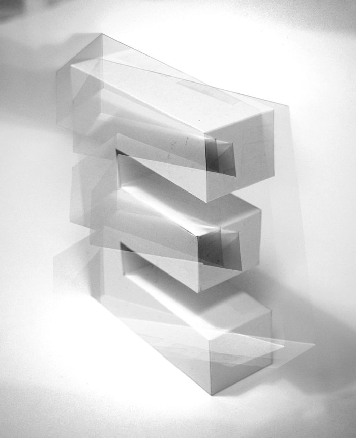 intersecting planes architecture. as in a piece of quartz, the letter has visible internal framework intersecting planes, which sometimes break surface to alter outer form. planes architecture